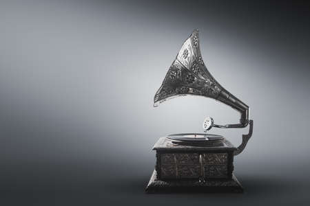 Old gramophone on a gray background
