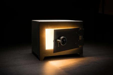 Steel money bank safe on a dark background / dramatic lit image 스톡 콘텐츠 - 114254923