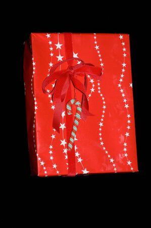 beautifully wrapped: Beautifully wrapped Christmas gift on black background Stock Photo