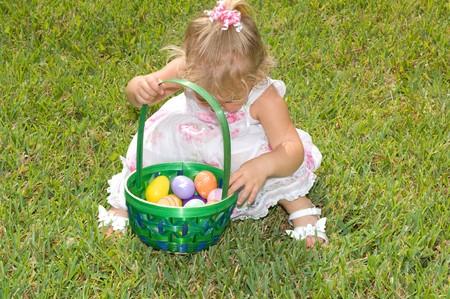 Adorable little girl on Easter egg hunt