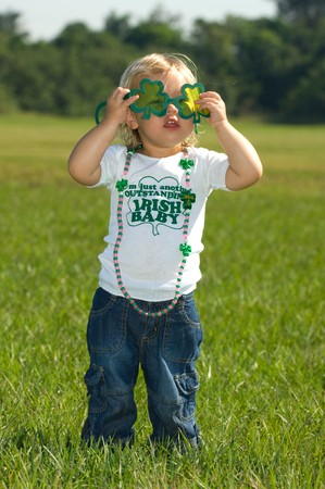 seventeenth: Adorable little girl in shamrock sunglasses Stock Photo