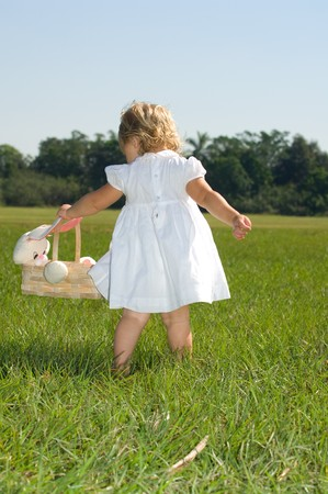 Little girl with bunny rabbit easter basket