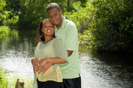 Man and Pregnant Woman Expecting Baby photo