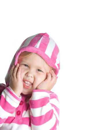 Adorable little blond girl smiling in pink and white hooded jacket Imagens