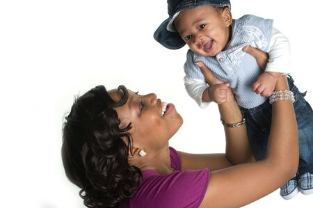 air baby: Mother Holding Baby Boy in the Air Smiling