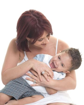 tickling: Mother tickling young son Stock Photo