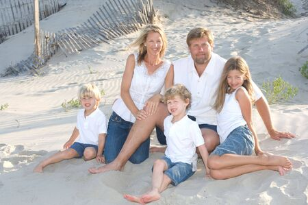 matching: Family of Five Smiling at the Beach