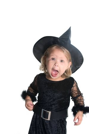 Adorable little girl dressed in witch costume  Stock Photo - 5589940