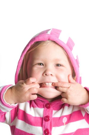 Adorable little blond girl making a funny face in a hooded jacket photo