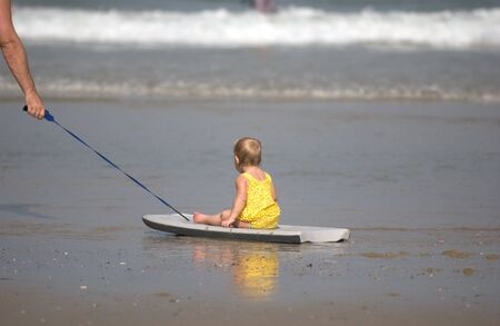 Little girl going for a ride at the beach  Stok Fotoğraf