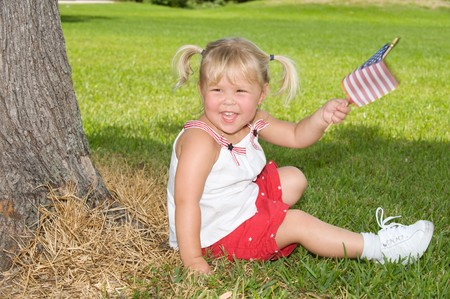 Adorable little girl smiling on Fourth of July
