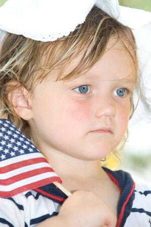 Adorable little girl celebrating the fourth of July