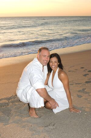 Beautiful couple smiling at the beach