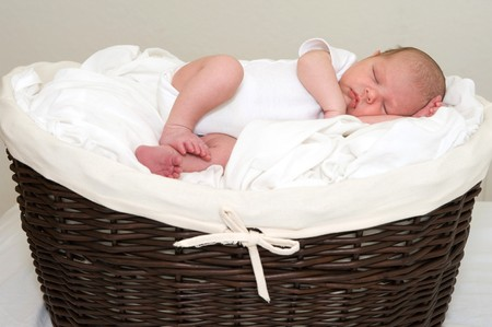 Beautiful baby boy sleeping in a blanket  photo