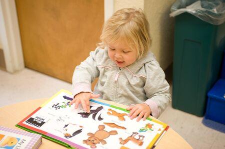 Adorable little girl in pre school