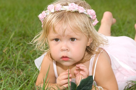 Beautiful blond little girl wearing a tutu