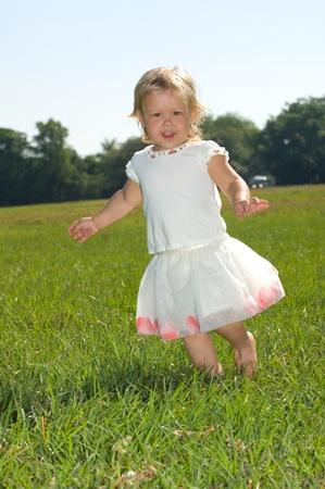 Adorable little girl outdoors at the park