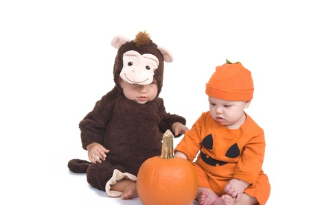 Adorable little boys wearing their Halloween costumes