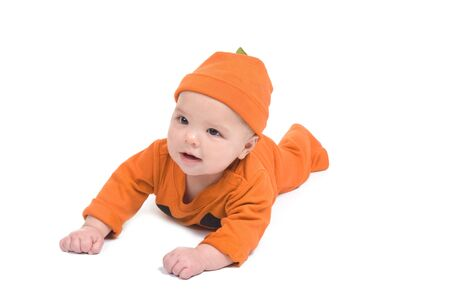 Adorable baby boy smiling in a pumpkin costume