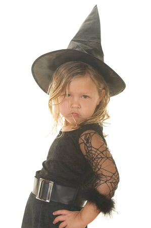 Adorable little blond girl making a face wearing a witch costume Stok Fotoğraf