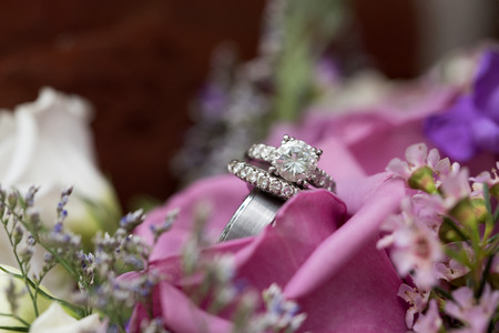 Beautiful wedding rings perched in lavender flowers