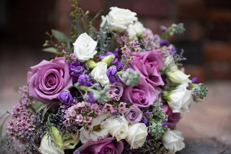 Gorgeous lilac bridal bouquet outdoors
