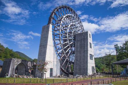 Large waterwheel with blue skies in Japan Redakční
