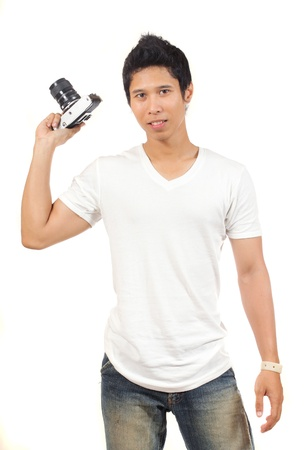 photographer in white shirt holding an old camera photo