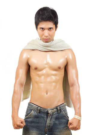 man standing and showing his body muscle photo