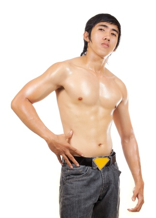 asian abs: man posing and showing his body
