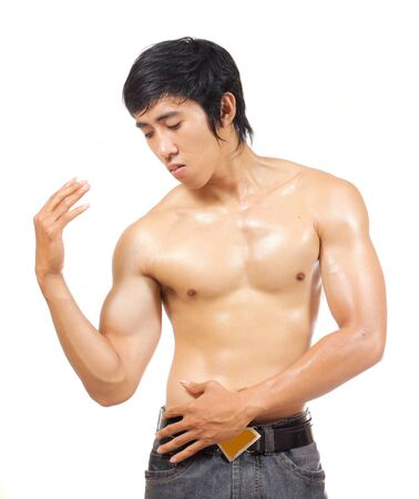 asian bodybuilder: man posing and showing his body muscle Stock Photo