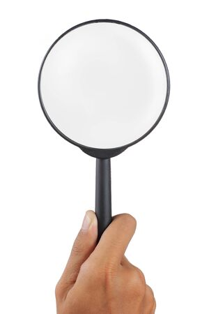 magnification: magnifier glass holded by man hand Stock Photo