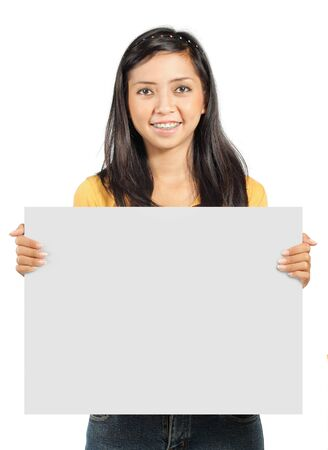 holding the head: cute young girl holding a big blank card Stock Photo
