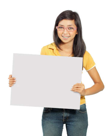Beautiful young girl smiling holding big blank card photo