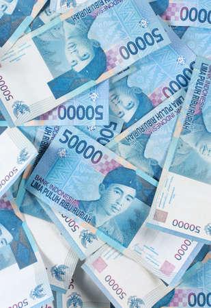 rupee: heap of rupiahs, much money as a background