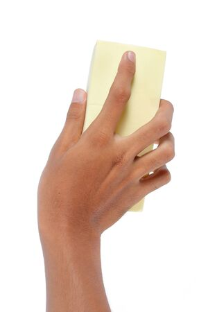 hand holding a sponge and cleaning something photo