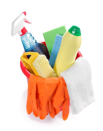 house chores: Red plastic bucket with many cleaning products inside Stock Photo