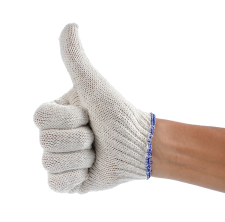 hand with white fabric glove showing thumb up photo
