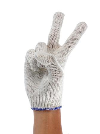 hand with white fabric glove gesturing photo
