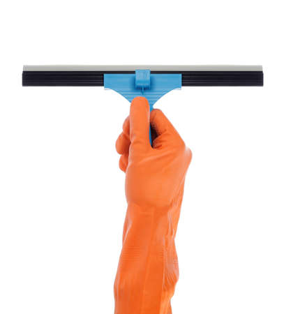 cleaning window: hand with orange glove holding window cleaner Stock Photo
