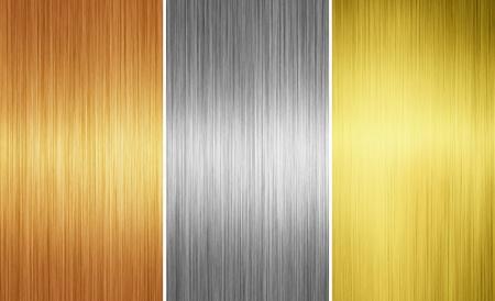 marca libros: tres diferentes texturas de metales para fondo Foto de archivo