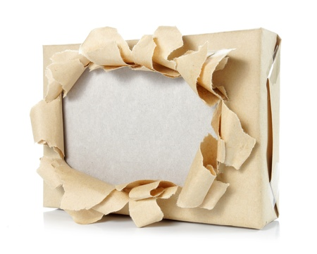close up of brown package paper torn  photo