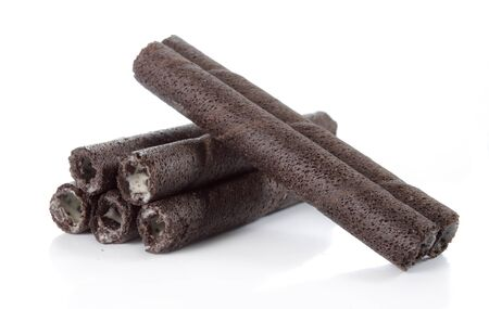 a pile of chocolate vanilla rolled wafer Stock Photo - 9603821
