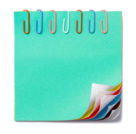 blank colorful note and colorful paper clip photo