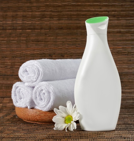 traquility: blank white bottle of beauty product with flower Stock Photo