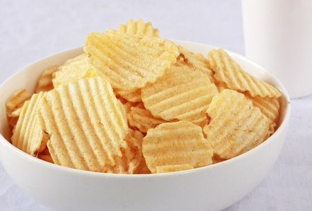 chips: a bowl of potato chips with a cup of drink Stock Photo