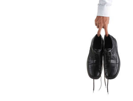 jobless man with shoe isoated on white background photo