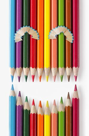 different concept: smiling color pencils isolated on white