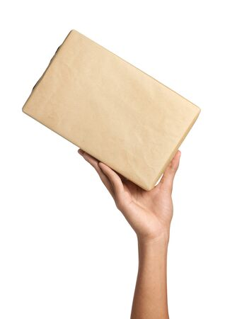 ship package: Delivery man holding a package