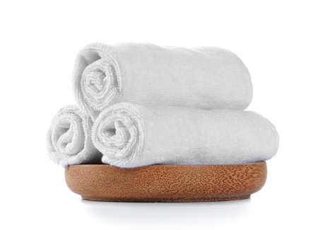 1 object: three pieces of white towels on wooden plate